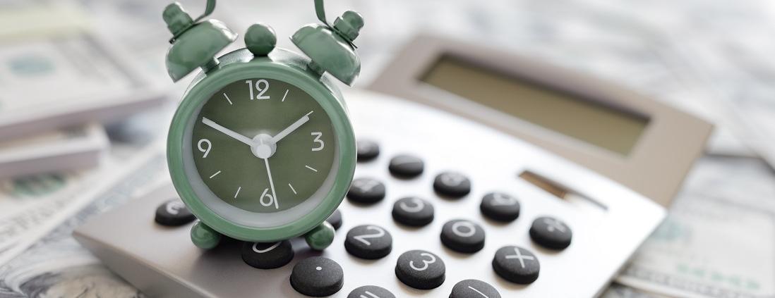 Calculator and alarm clock